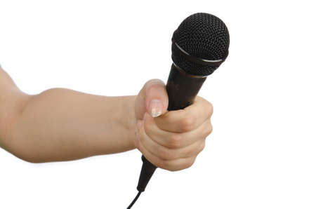 Hand with microphone on white Stock Photo - 14274344