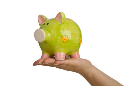 Hand with piggybank on white background photo