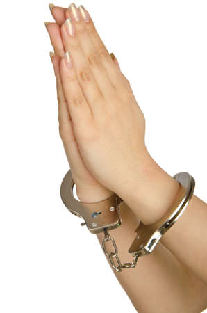 Handcuffed hands on white background Stock Photo - 14274587