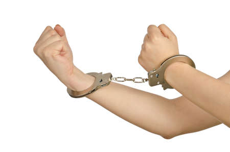 Handcuffed hands on white background Stock Photo - 14274381