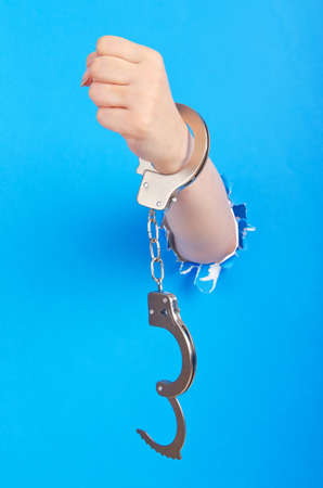 Hand with handcuffs out of paper Stock Photo - 14275116