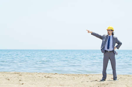 Oil engineer on sea side beach photo