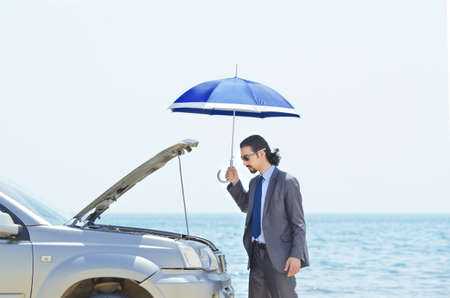 Man with car on seaside Stock Photo - 14385243
