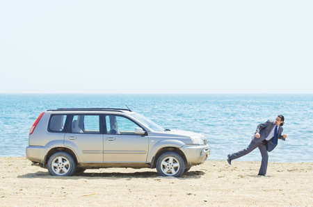 Man with car on seaside Stock Photo - 14385339