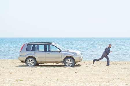 Man with car on seaside photo