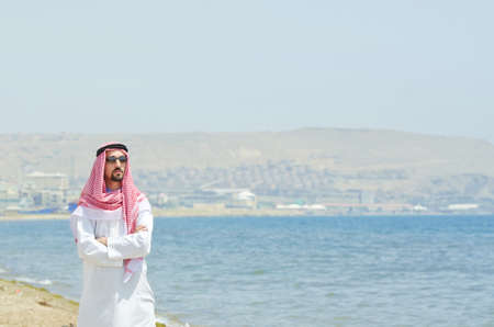Arab on seaside in traditional clothing photo
