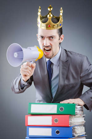 Man with crown and loudspeaker photo