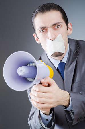Businessman shouting via loudspeaker Stock Photo - 14385487