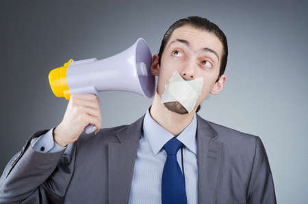Businessman shouting via loudspeaker photo