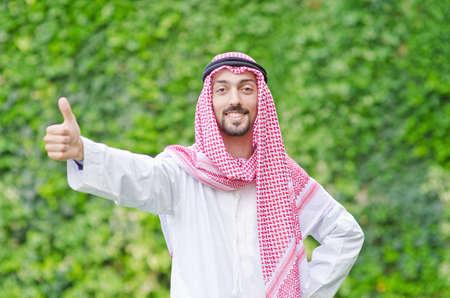 dishdasha: Arab on the street in summer Stock Photo