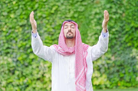 Arab on the street in summer Stock Photo