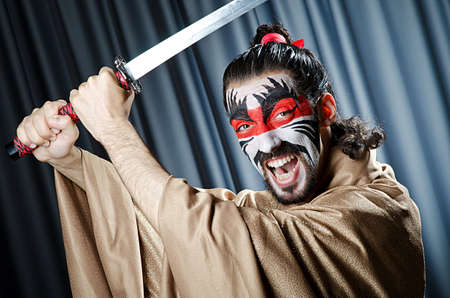 Man with face mask and sword photo