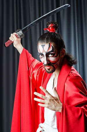 Man with face mask and sword Stock Photo - 14385530