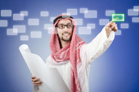 Young arab pressing virtual buttons Stock Photo - 14385395