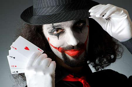 Joker with cards in studio shoot photo