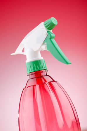 Garden sprayer against gradient background photo