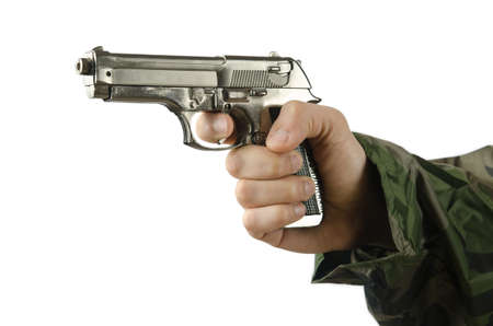 Gun in the hand on white photo