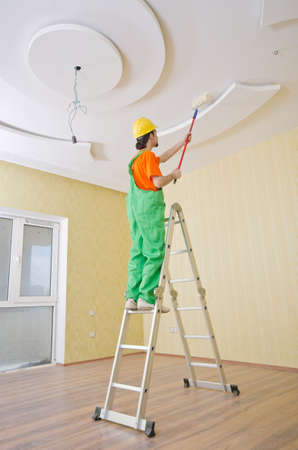 Painter worker during painting job photo