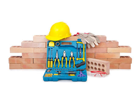 Construction concept with helmet and toolkit photo