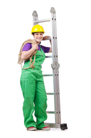 Woman worker standing on ladder photo