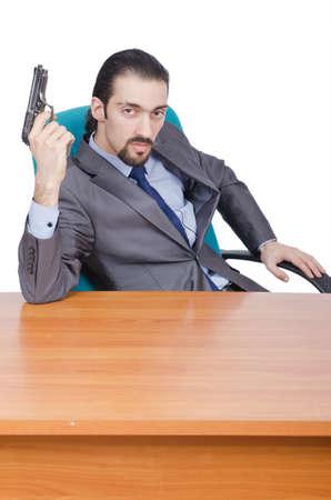 Businessman with gun on white photo