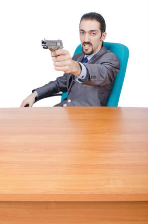Businessman with gun on white photo