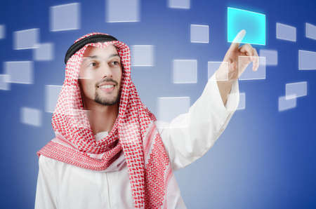 Young arab pressing virtual buttons Stock Photo - 14409237