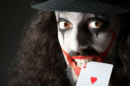 Joker with cards in studio shoot Stock Photo - 14409274