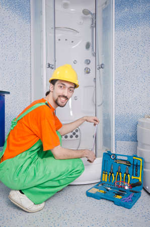 Plumber working in the bathroom photo