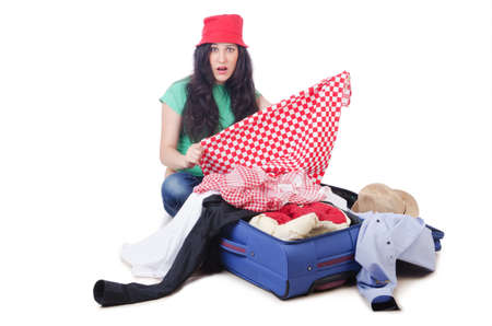 Girl packing for travel vacation Stock Photo - 14409102