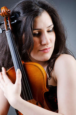 Female violin player against background Stock Photo - 14409275