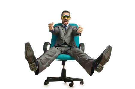 Businessman sitting in the chair on white photo