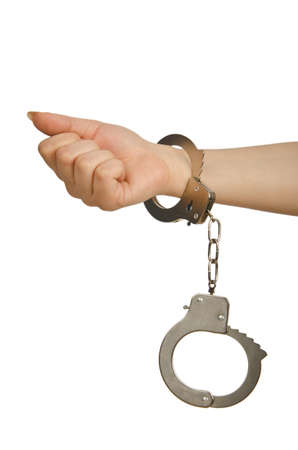 handcufs: Handcuffed hands on white background Stock Photo