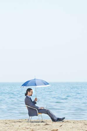 Man with umbrella on seaside beach Stock Photo - 14425494