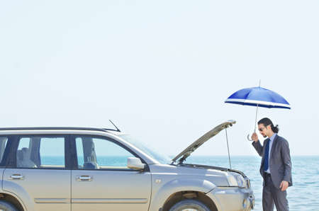 Man with car on seaside Stock Photo - 14425492