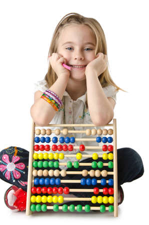 Girl with abacus on white Stock Photo - 14425521