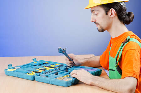 Repairman with his toolkit Stock Photo - 14425629