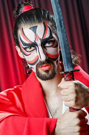 Man with face mask and sword Stock Photo - 14425751