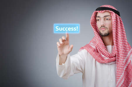 Young arab pressing virtual buttons Stock Photo - 14425659