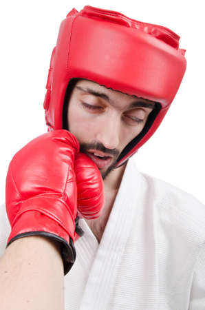 Karate fighter isolated on the white photo