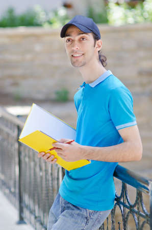 Student outside preparing for exams photo