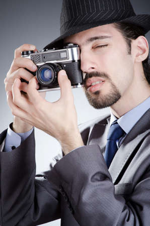 Photographer man with vintage camera photo