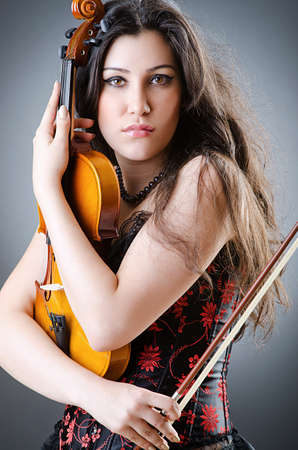Female violin player against background Stock Photo - 14425737