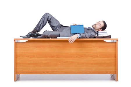 Businessman sleeping at this desk Stock Photo - 14425474