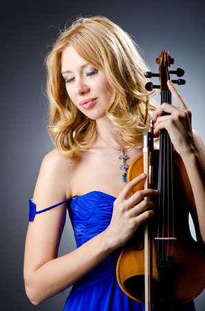 Woman with violin in studio Stock Photo - 14703768