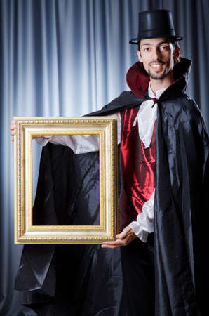 Magician with photoframe in studio Stock Photo - 14703763
