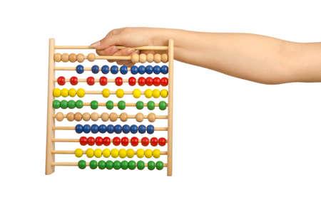 Hand holding abacus on white photo