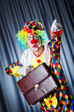 Clown with business briefcase photo