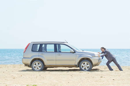 Man with car on seaside Stock Photo - 14703713