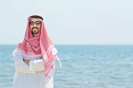 Arab on seaside in traditional clothing Stock Photo - 14703717